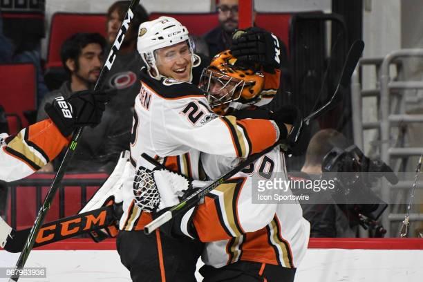 Anaheim Ducks Center Dennis Rasmussen celebrates with Anaheim Ducks Goalie Ryan Miller during a game between the Anaheim Ducks and the Carolina...