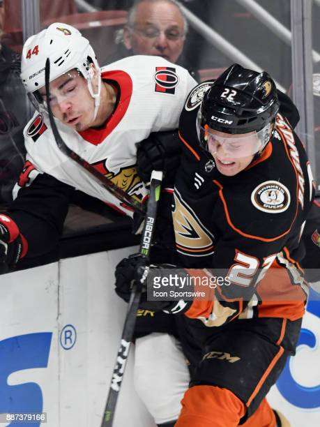 Anaheim Ducks center Dennis Rasmussen puts Ottawa Senators center JeanGabriel Page into the boards in the first period of a game played on December 6...