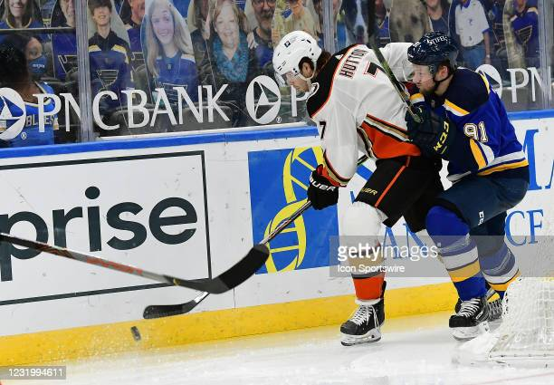 Anaheim Ducks defenseman Ben Hutton goes after a loose puck with pressure from St. Louis Blues right wing Vladimir Tarasenko during a NHL game...