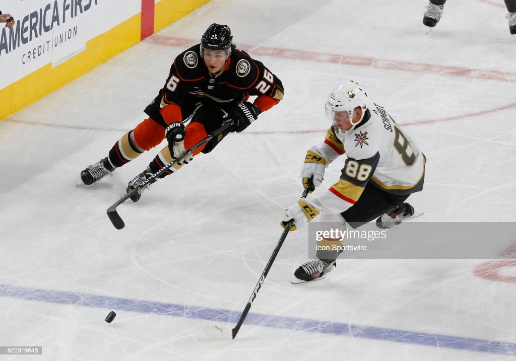 Anaheim Ducks defenseman Brandon Montour (26) and Vegas Golden Knights defenseman Nate Schmidt (88) skate for control of the puck during the third period of a regular season NHL game between the Anaheim Ducks and the Vegas Golden Knights at T-Mobile Arena Monday, Feb. 19, 2018, in Las Vegas, Nevada. The Anaheim Ducks would defeat the Vegas Golden Knights 2-0.
