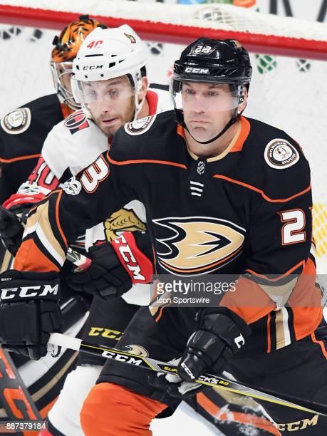 Anaheim Ducks defenseman Francois Beauchemin stays in front of Ottawa Senators center Gabriel Dumont in the first period of a game played on December...