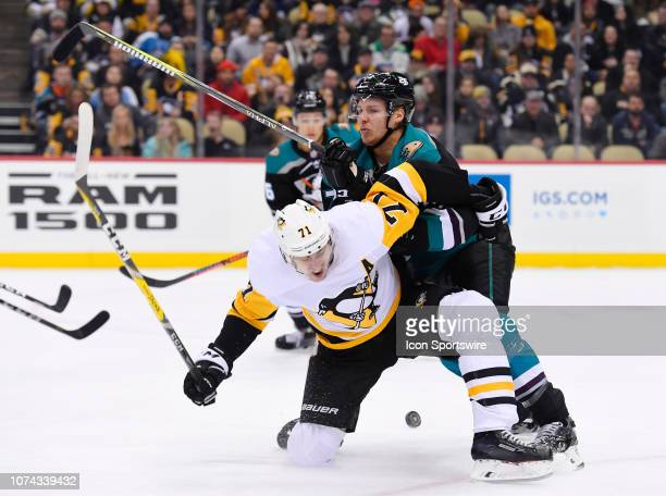 Anaheim Ducks Defenseman Hampus Lindholm checks Pittsburgh Penguins Center Evgeni Malkin off the puck during the first period in the NHL game between...