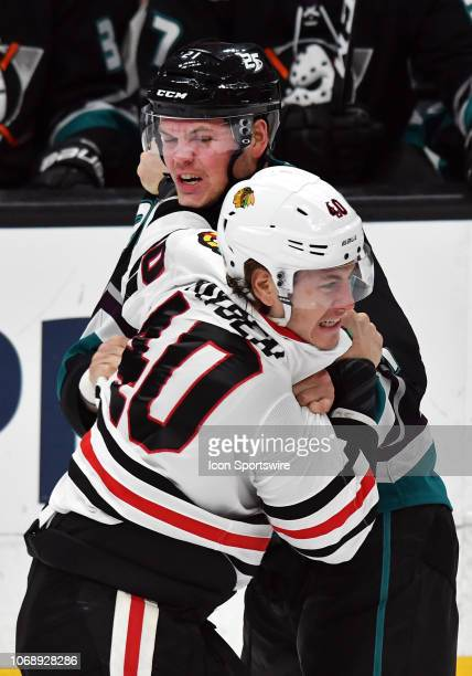 Anaheim Ducks defenseman Jake Dotchin and Chicago Blackhawks rightwing John Hayden fight in the first period of a game played on December 5 2018 at...