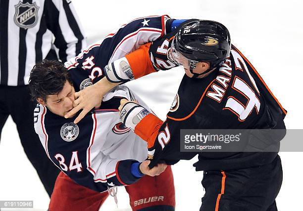 Anaheim Ducks defenseman Josh Manson and Columbus Blue Jackets right wing Josh Anderson get into a fight in the first period of a game played on...