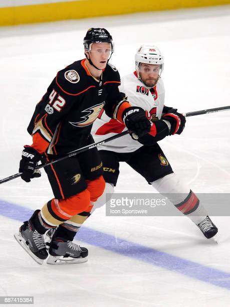 Anaheim Ducks defenseman Josh Manson in action with Ottawa Senators center Gabriel Dumont in the third period of a game played on December 6 2017 at...