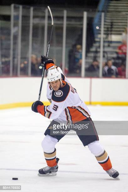 Anaheim Ducks defenseman Kevin Bieksa prepares to hit the puck during a preseason hockey game between the Anaheim Ducks and Arizona Coyotes on...