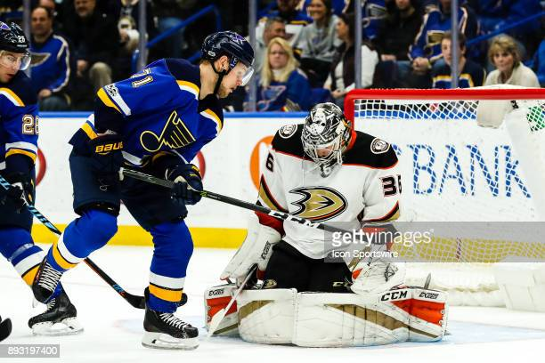 Anaheim Ducks goalie John Gibson makes a save as St Louis Blues' Vladimir Sobotka left waits for a rebound during the second period of an NHL hockey...
