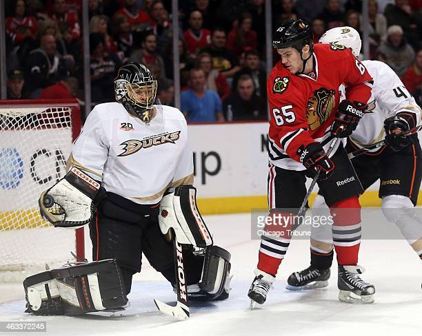 Anaheim Ducks goalie Jonas Hiller left makes a glove save as the Chicago Blackhawks' Andrew Shaw looks for a rebound in the first period on Friday...