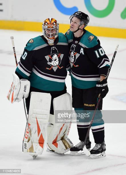 Anaheim Ducks goalie Kevin Boyle with rightwing Corey Perry after Boyle recorded his first career NHL victory and shutout in his first NHL start in a...