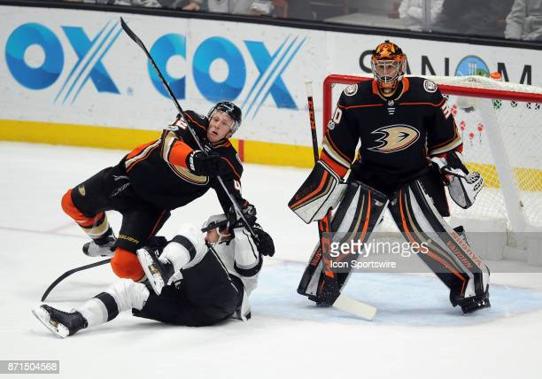 Anaheim Ducks goalie Ryan Miller in action along with Ducks defenseman Josh Manson and Los Angeles Kings rightwing Dustin Brown during the third...