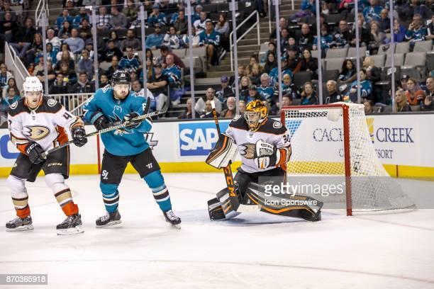 Anaheim Ducks goalie Ryan Miller makes a save as San Jose Sharks center Joe Pavelski looks to deflect the puck during the third period of the regular...
