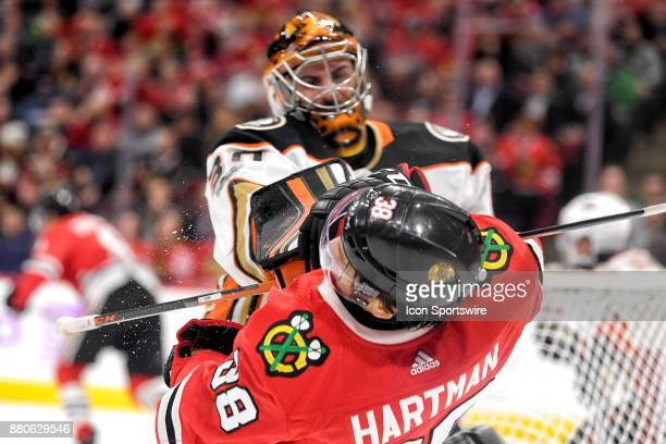 Anaheim Ducks goalie Ryan Miller punches Chicago Blackhawks left wing Ryan Hartman after a play in the second period during a game between the...