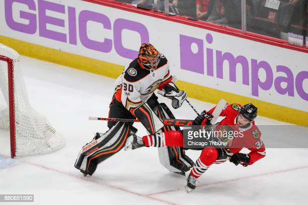 Anaheim Ducks goalie Ryan Miller pushes Chicago Blackhawks left wing Ryan Hartman on the ice during the second period on Monday Nov 27 2017 at the...