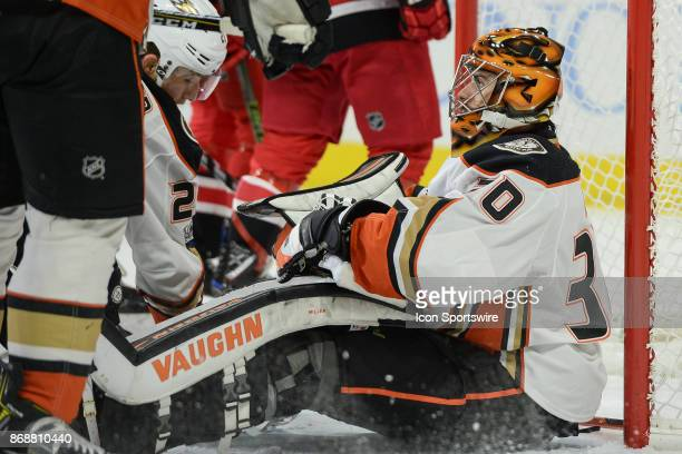 Anaheim Ducks Goalie Ryan Miller sits on the ice after a Carolina goal during a game between the Anaheim Ducks and the Carolina Hurricanes at the PNC...