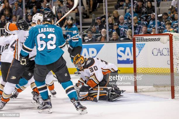 Anaheim Ducks goalie Ryan Miller traps the puck in front of the net during the first period of the regular season game between the San Jose Sharks...