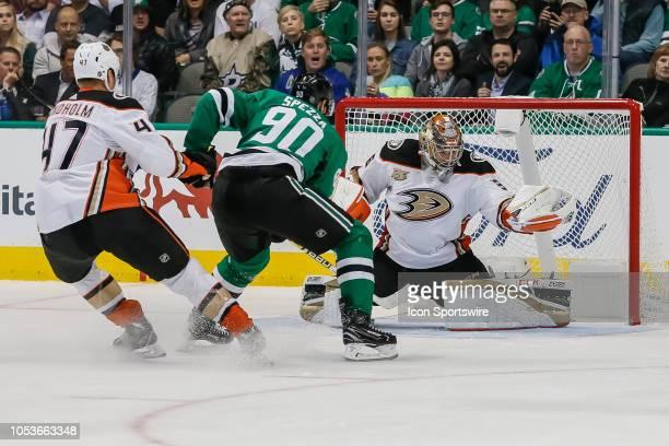 Anaheim Ducks goaltender John Gibson blocks a shot from Dallas Stars center Jason Spezza during the game between the Dallas Stars and the Anaheim...