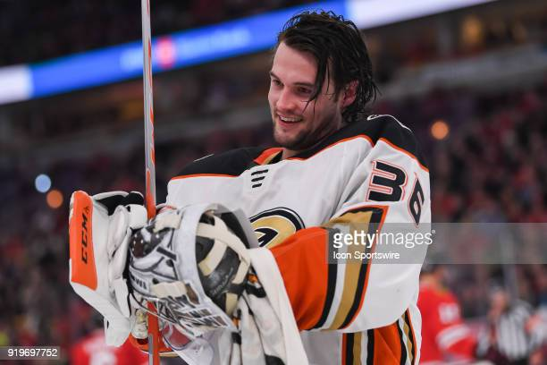 Anaheim Ducks goaltender John Gibson smiles prior to putting his helmet on during a game between the Chicago Blackhawks and the Anaheim Ducks on...