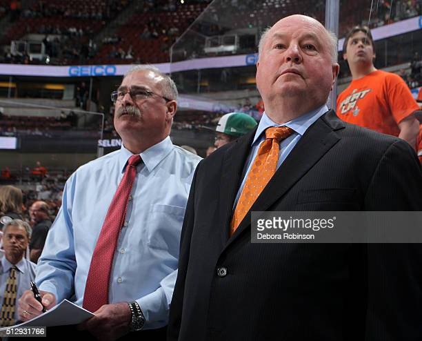 Anaheim Ducks head coach Bruce Boudreau and assistant coach Paul MacLean look on during pregame warmups before the game against the Los Angeles Kings...