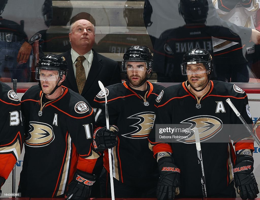 Anaheim Ducks head coach Bruce Boudreau looks up at the scoreboard from the bench as Ducks players watch the action on the ice against the Detroit Red Wings. March 22, 2013 at Honda Center in Anaheim, California.