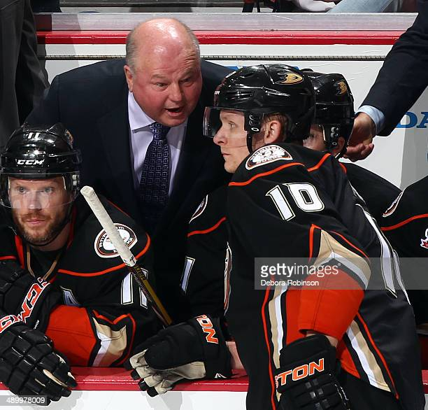 Anaheim Ducks head coach Bruce Boudreau talks with Corey Perry during the game against the Los Angeles Kings in Game Five of the Second Round of the...