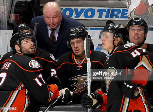 Anaheim Ducks head coach Bruce Boudreau talks with his players during the game against the Tampa Bay Lightning on December 2 2015 at Honda Center in...