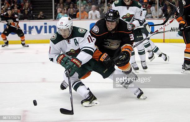 Anaheim Ducks left wing Matt Beleskey can't keep the offense going as Minnesota Wild Zach Parise clears the puck in the second period at Honda Center...
