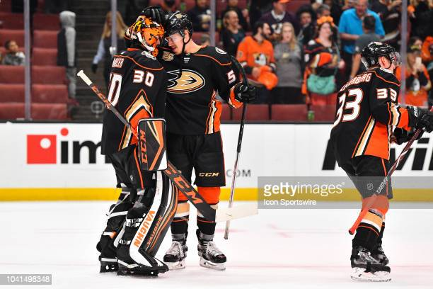 Anaheim Ducks left wing Max Comtois congratulates goalie Ryan Miller after a NHL preseason game between the Los Angeles Kings and the Anaheim Ducks...