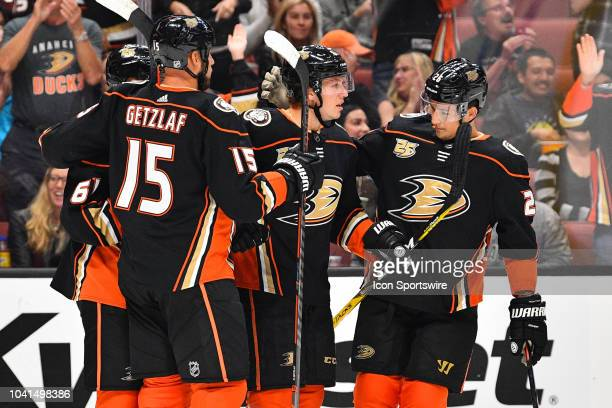 Anaheim Ducks left wing Max Comtois is greeted by Ryan Getzlaf among others after his goal during a NHL preseason game between the Los Angeles Kings...