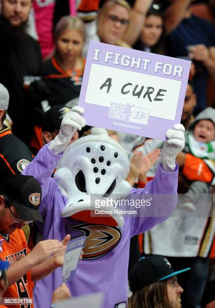 Anaheim Ducks mascot Wild Wing hold a sign supporting Hockey Fights Cancer night during the game against the Buffalo Sabres on October 15 2017 at...