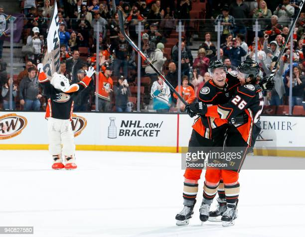 Anaheim Ducks mascot Wild Wing Ondrej Kase and Brandon Montour of the Anaheim Ducks celebrate Kase's overtime goal as the Ducks defeat the Colorado...