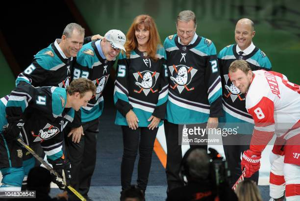 Anaheim Ducks owners Henry and Susan Samueli at center after dropping the first puck in celebration of the 25th anniversary of the Duck franchise...
