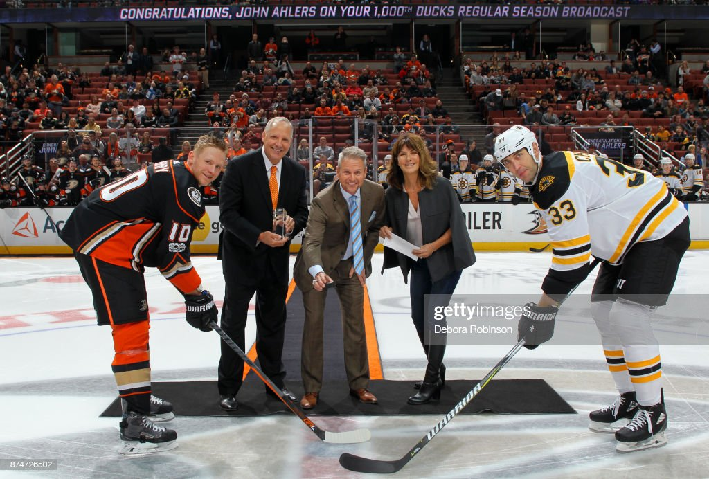 Anaheim Ducks play-by- play announcer John Ahlers, center, stands at center ice with his wife, Cyndi, Anaheim Ducks Executive Vice President and COO Tim Ryan, Zdeno Chara #33 of the Boston Bruins, and Corey Perry #10 of the Anaheim Ducks for a puck drop ceremony prior to the game on November 15, 2017 at Honda Center in Anaheim, California.