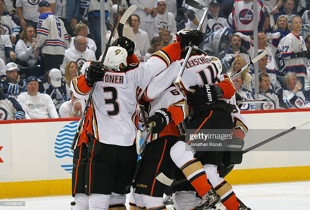 Anaheim Ducks players celebrate a 5-4 overtime goal by Rickard Rakell #67 (not shown) over the Winnipeg Jets in Game Three of the Western Conference Quarterfinals during the 2015 NHL Stanley Cup Playoffs on April 20, 2015 at the MTS Centre in Winnipeg, Manitoba, Canada. The Ducks lead the series 3-0.