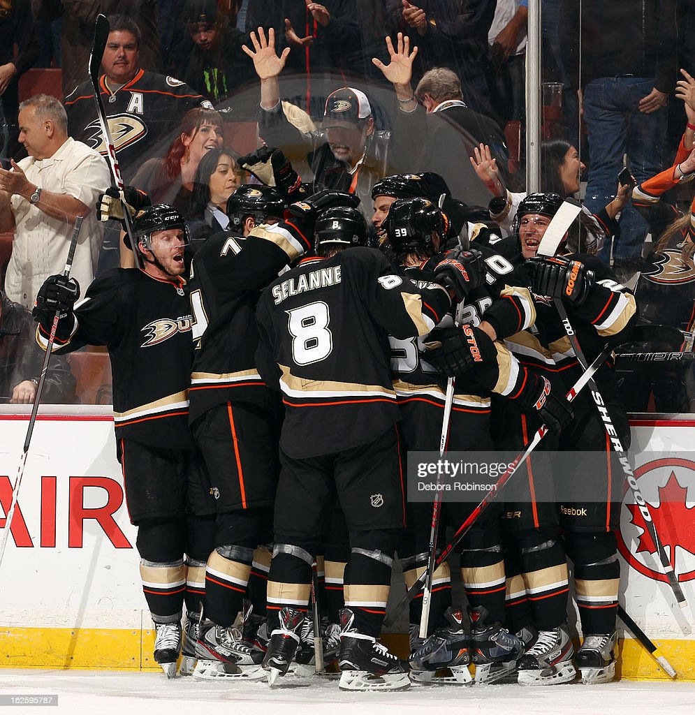 Anaheim Ducks players celebrate their 4-3 overtime win against the Colorado Avalanche on February 24, 2013 at Honda Center in Anaheim, California.