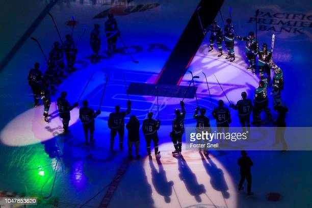 Anaheim Ducks players raise their sticks during introductions prior to the game against the Detroit Red Wings on October 8 2018 at Honda Center in...