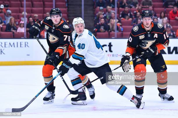 Anaheim Ducks right wing Corey Perry and defensemen Josh Mahura try to defend San Jose Sharks center Antti Suomela during a NHL preseason game...