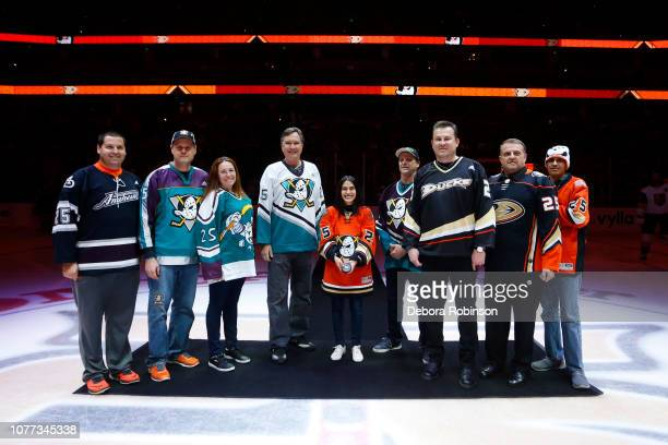 Anaheim Ducks season ticket holders or OAM Orange Alliance Members pose for a photo during the ceremonial puck drop prior to the game between the...