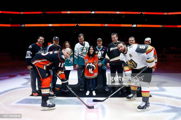 Anaheim Ducks season ticket holders or OAM Orange Alliance Members participate in the ceremonial puck drop along with Ryan Getzlaf of the Anaheim...