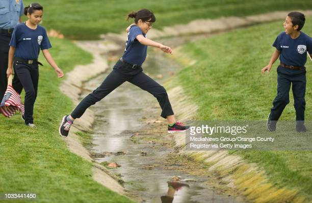 Anaheim Jr Cadets puddle jump to get to another side of Riverside National Cemetery on SaturdayThey were volunteering with A flag for Every Hero an...