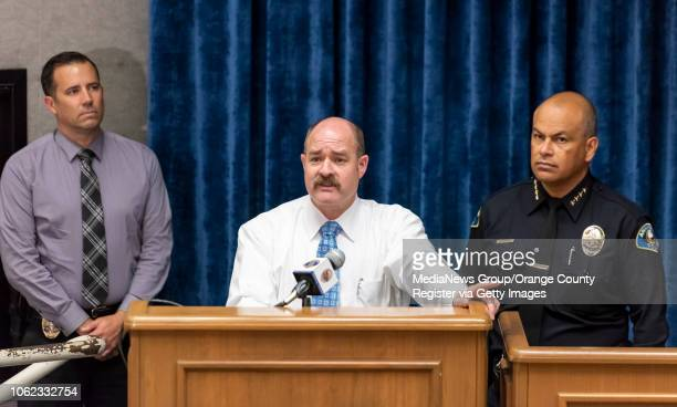 Anaheim Police from left Sgt Jeff Mundy and Sgt Daron Wyatt and police chief Jorge Cisneros field questions from the media during a press conference...