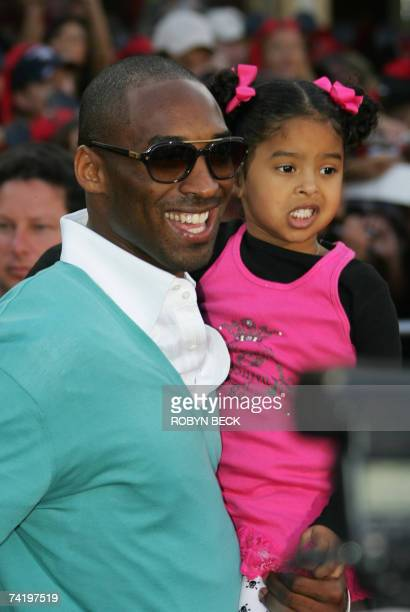 """Anaheim, UNITED STATES: Basketball player Kobe Bryant and daughter Natalia arrive for the premiere of Walt Disney's """"Pirates Of The Caribbean: At..."""