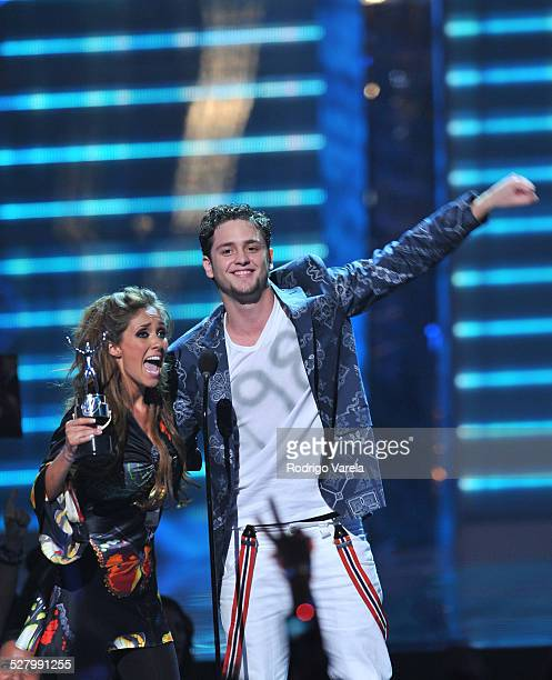 Anahi and Christopher Uckermann performs on stage at Univision's 2009 Premios Juventud Awards at Bank United Center on July 16 2009 in Coral Gables...