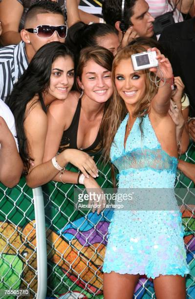 Anahi Giovanna Puente of the band RBD poses with fans at the Bank United Center for the Premios Juventud Awards on July 19 2007 in Coral Gables...