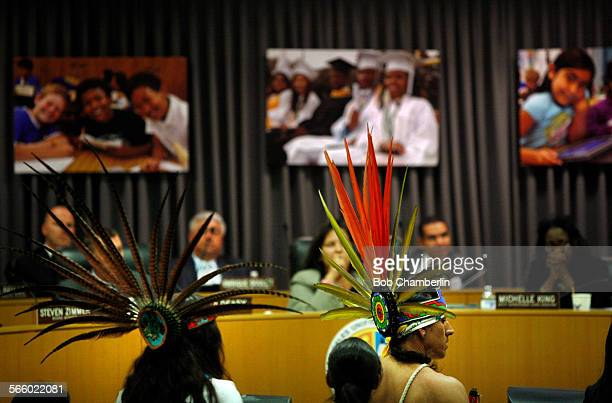 Anahuacalmecac Charter School principle Marcos Aguilar dressed in Aztec costume center and others appeared before the LAUSD board to ask them to...