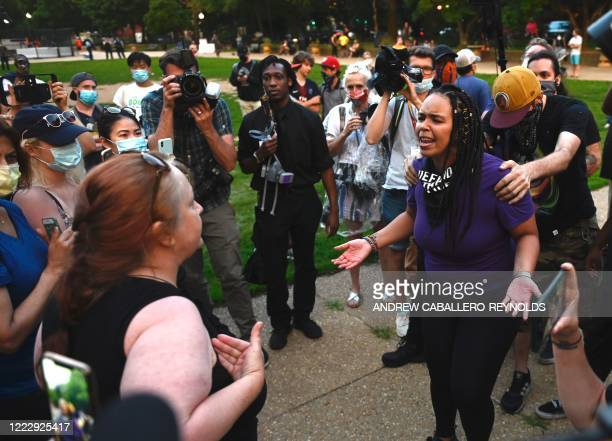 Anais an activist who wants the Emancipation Memorial removed speaks with Suzzana Monk at Lincoln Park in Washington DC on June 25 2020 As the wave...