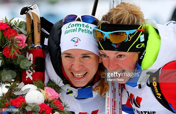 Anais Bescond of Frace and Marie Dorin Habert of France celebrate their medals in the women's 15km individual during day six of the IBU Biathlon...
