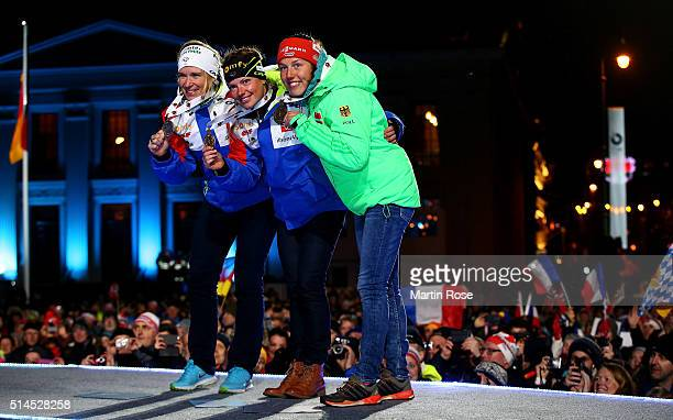 Anais Bescond of Frace, Marie Dorin Habert of France and Laura Dahlmeier of Germany celebrate their medals in the women's 15km individual during day...