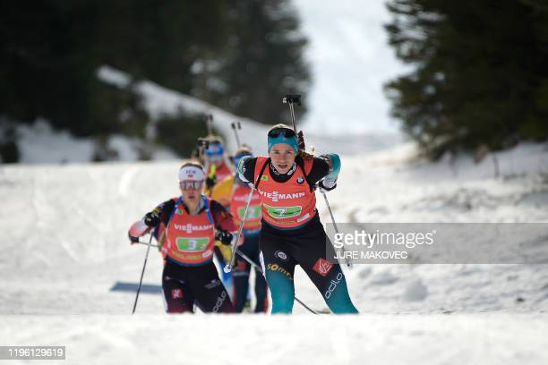 Anais Bescond of France and Karoline Offigstad Knotten of Norway compete during the IBU Biathlon World Cup Single Mixed Relay event at Pokljuka on...