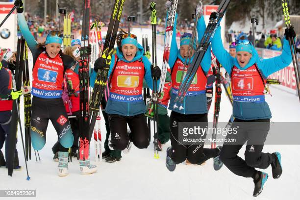Anais Chevalier of France and her team mates Justine Braisaz Anais Bescond and Julia Simon celebrate victory after winning the Women 4x6 km Relay...