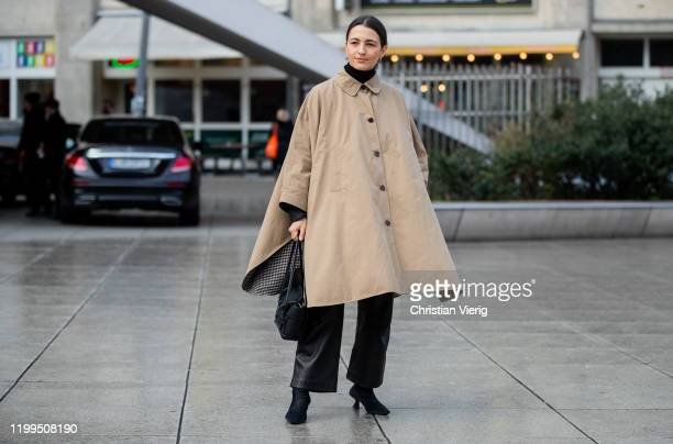 Anais Eleni seen wearing beige cape, flared pants, black bag during the Berlin Fashion Week Autumn/Winter 2020 on January 14, 2020 in Berlin, Germany.